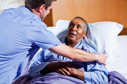 man being comforted in hospital bed
