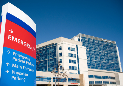 Front entrance of a hospital showing Emergency sign