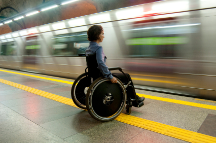 woman in wheelchair waiting for a train
