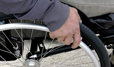 Side of a wheelchair and hands