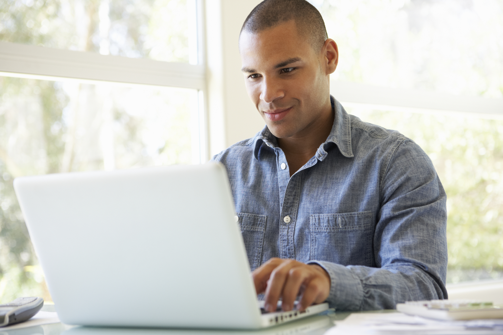 man looking at computer smiling