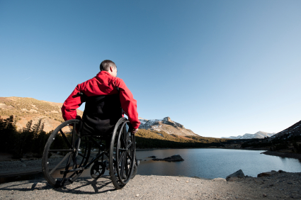 Man in wheelchair looking out at a lake