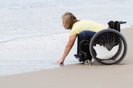 woman on wheelchair at the beach