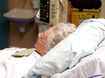 woman laying in hospital bed