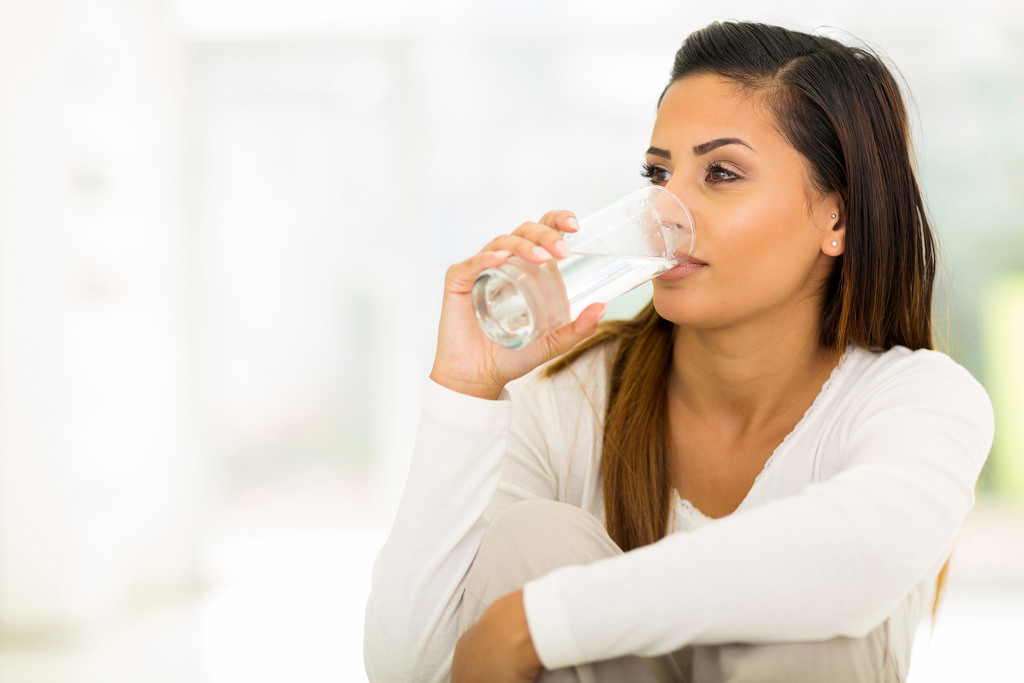 woman drinking out water bottle