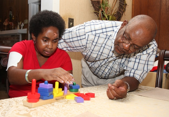Father teaching child with blocks