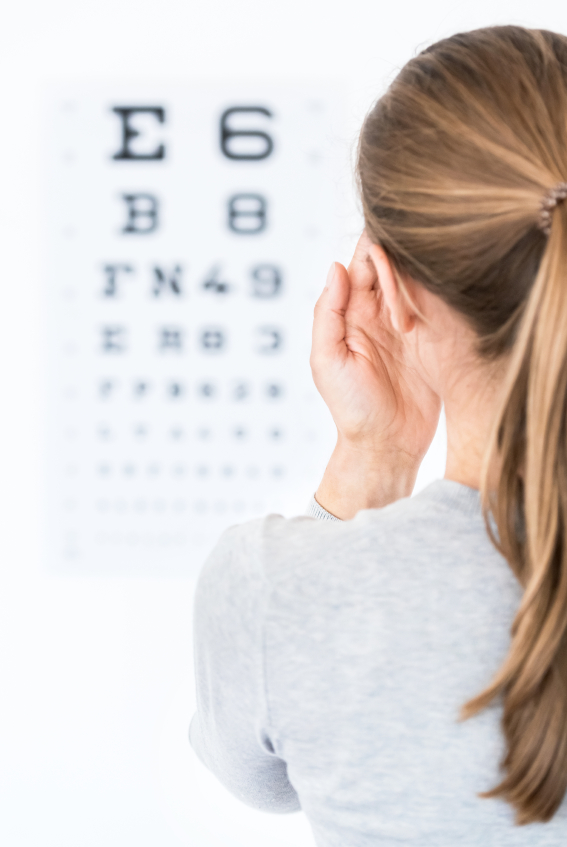 Young woman reading eye chart