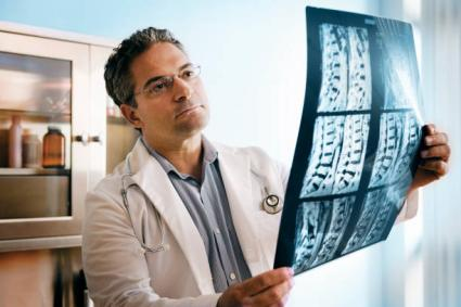 Doctor looking at spinal cord xray