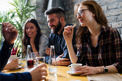 A group of friends laughing and hanging out in a coffee shop