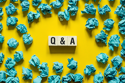 Q and A written in middle surrounded by crumpled paper
