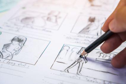 An artist sketching a comic.