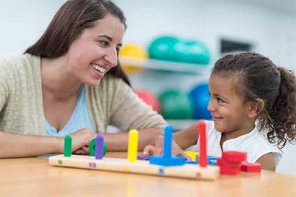 Occupational Therapist with Young Girl