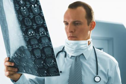 Clinician looking at brain scans