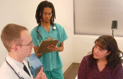 Woman being consulted by doctor