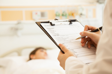 Doctor making notes in patient's chart