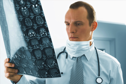 Doctor looking at scans of brain