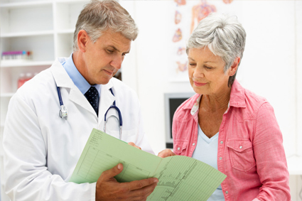 Doctor going over chart with patient